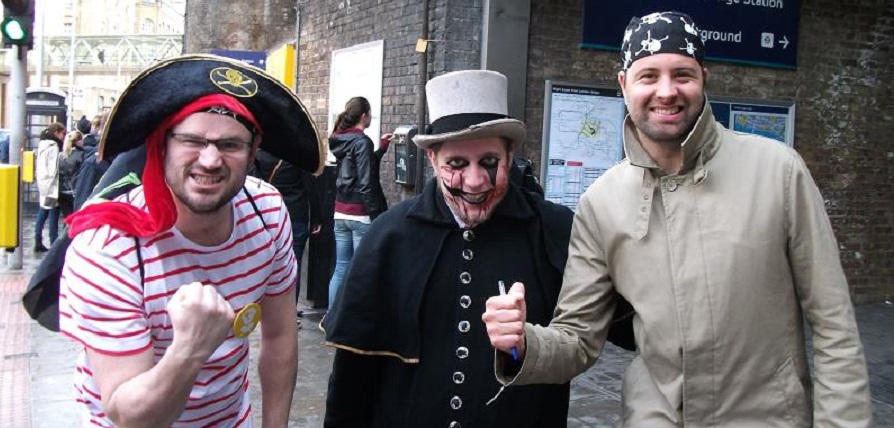 Three men on a treasure hunt in the UK dressed as pirates and a ghoul.